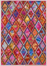 A diamond patchwork quilt by Kaffe Fassett. Photo credit: John Stewart. Image courtesy of Abrams/STC Craft/Melanie Falick Books.