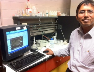Dr. Andrew Gomes analyzes research data in the Lamar University laboratory.