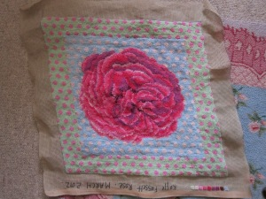 The 'Kaffe Fassett' rose immediately inspired a needlepoint by the textile artist. Photo courtesy of Brandon Mably.