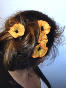 Flower clips by GardenFelt adorn an updo. Photo courtesy of Amy Green Thrasher.